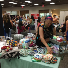 Vendor displays her products at an expo
