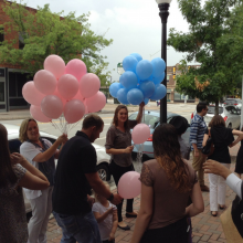 Passing out balloons to event attendees