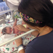 Mother looking at her baby in the NICU