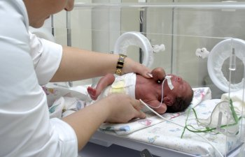 NICU nurse with baby