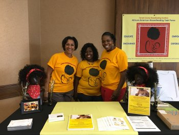 Representatives of the African American Breastfeeding Task Force at their vendor table