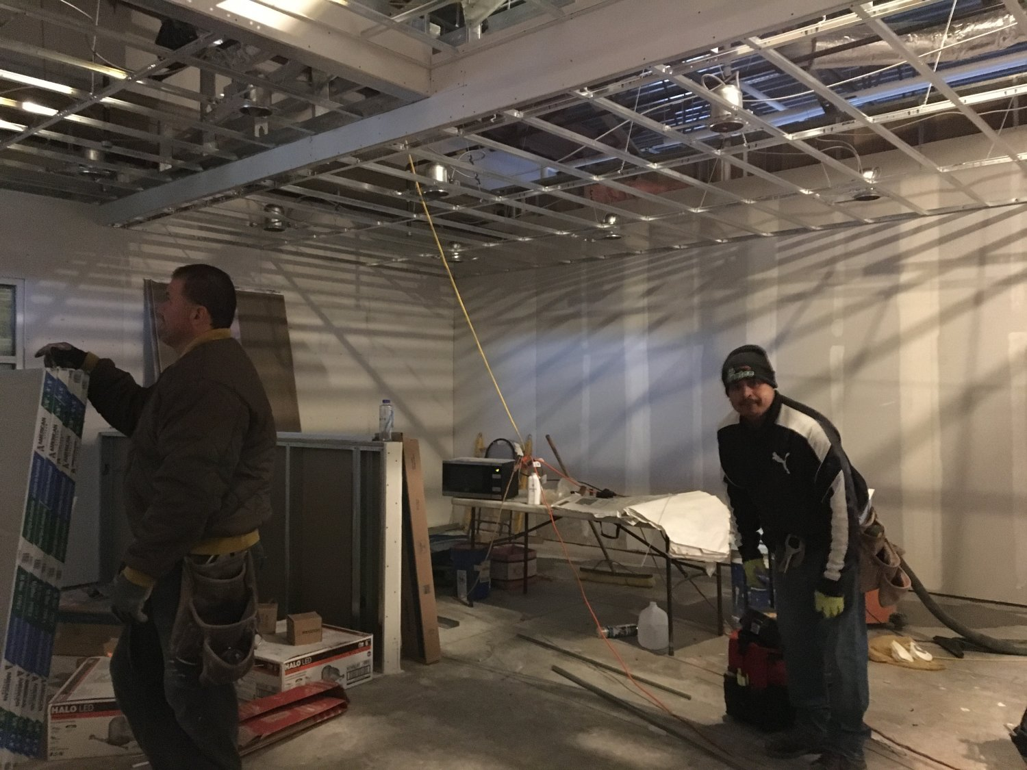 Two men standing in indoor construction site