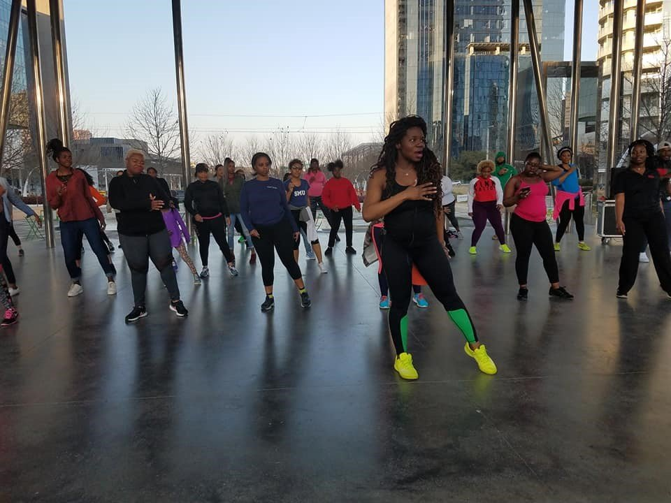 Woman leading group exercise class