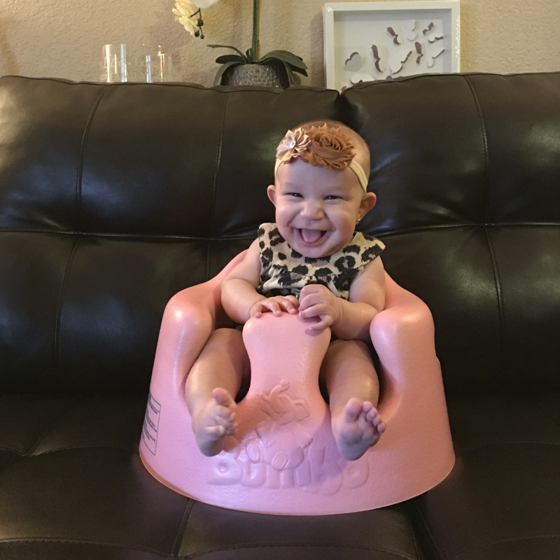 Baby sitting in bumbo seat