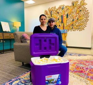 Carmen and Jose deliver breastmilk donation.