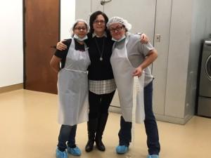 Executive Director, Amy Vickers & lab technicians, Fabby & Elizabeth, celebrating renovation progress